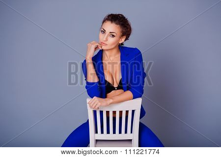 Portrait of gorgeous young caucasian attractive sexy woman with wearing blue jacket, pants and black