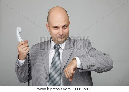 Bald businessman with the handset