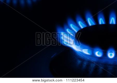 Gas burner fire on black background