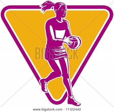 netball player ready to pass ball