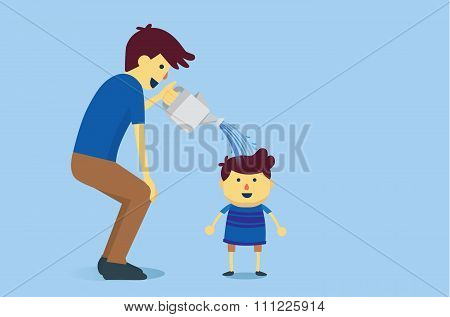 Father watering a son