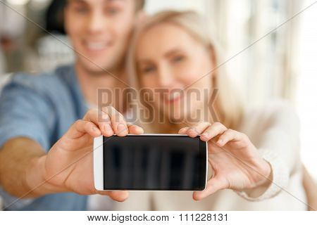 Pleasant couple making photos
