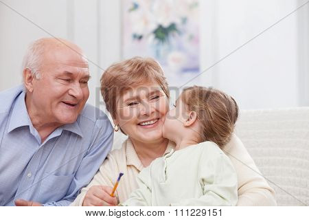 Pretty grandparents are taking care of child