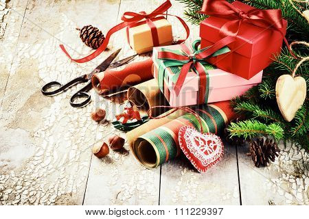 Holiday Setting With Handmade Gift Boxes And Wrapping Paper