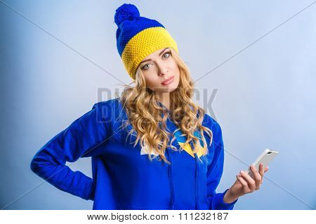 Blonde Woman Holding A Phone