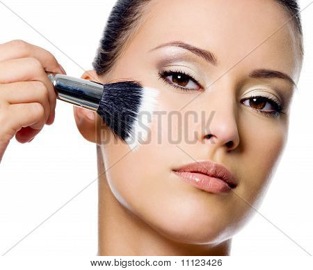 Beautiful Woman Applying Rough On Cheek