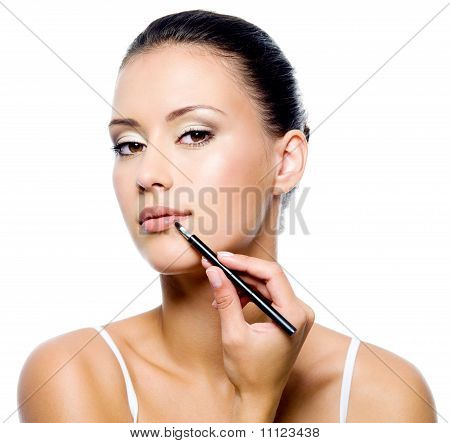 Beauty Woman Applying Lipstick