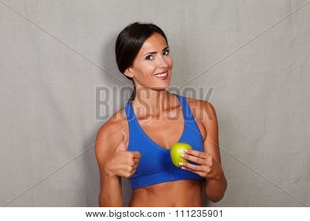 Lady Holding Apple And Showing Thumb Up