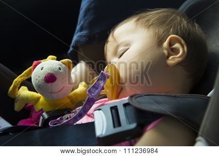 Baby Girl Sleeping In The Child Car Seat