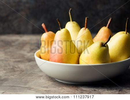 Fresh Organic Pears in the plate Copy space