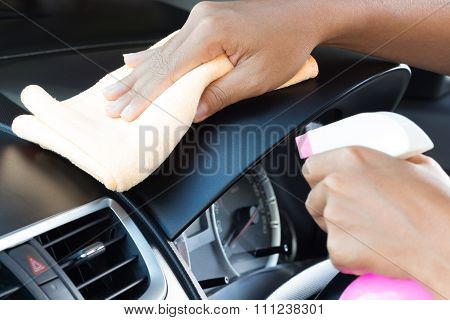 Closeup Hand Cleansing Car Dashboard