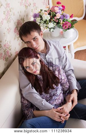 Couple Sitting On The Sofa Together
