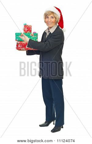 Senior Business Woman Hold Christmas Presents