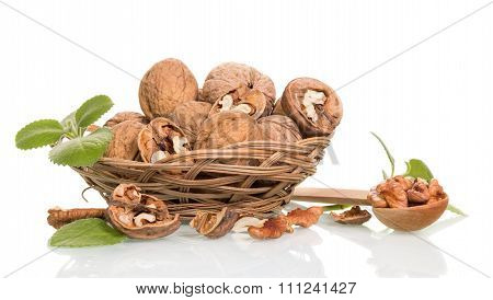 Nuts in wicker basket and scoop
