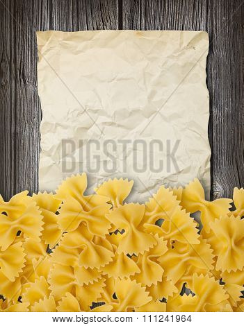 Pasta Farfalle On Wooden Backgroun