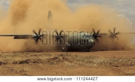 NANYUKI, KENYA - CIRCA OCTOBER 2015 - British RAF Hercules aircraft on airstrip during training exercise with British Army. Exercise is to prepare army and airforce for possible deployment to Syria.