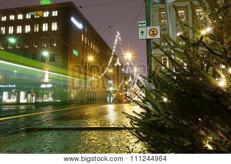 Helsinki city tram on Aleksanterikatu street on wet December evening