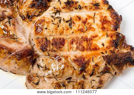 Grilled pork steak with cowberry sauce.