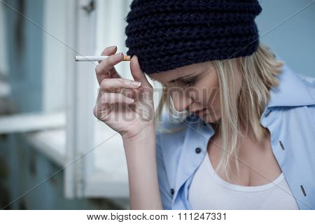 Frustrated blond female druggie has unhealthy lifestyle