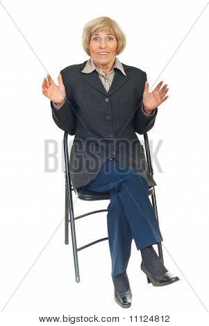 Amazed Senior Executive On Chair