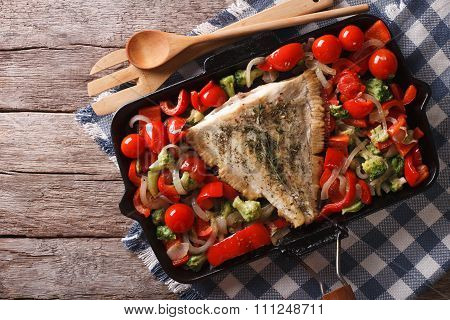 Flounder With Vegetables On A Frying Pan. Horizontal Top View