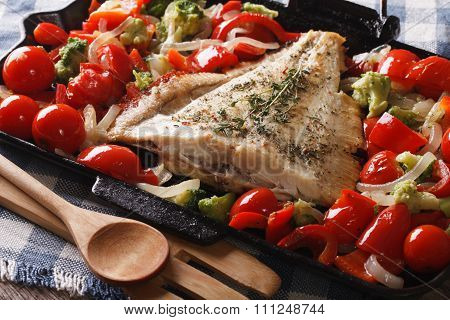 Homemade Flatfish With Vegetables Close-up In A Pan. Horizontal
