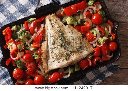 Tasty Flounder With Vegetables Close-up In A Pan. Horizontal Top View