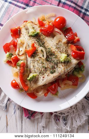 Delicious Baked Flounder With Vegetables Closeup. Vertical Top View