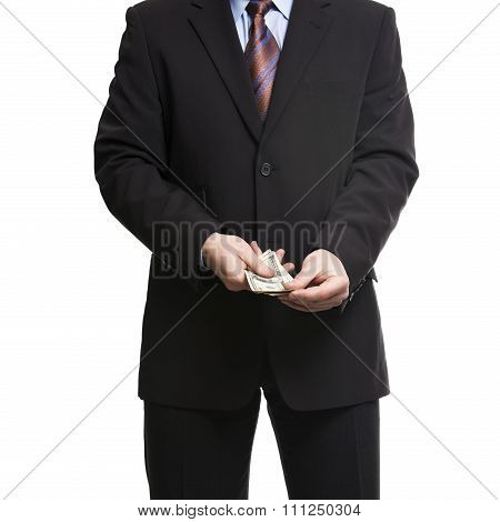 Businessman In Dark Suit With A Bunch Of American Dollars