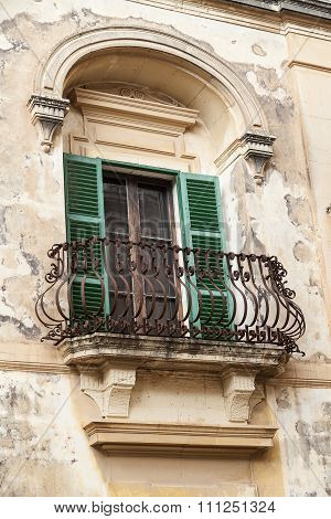 Typical Wooden Balcony With Shutter On Old Building In Mdina, Malta
