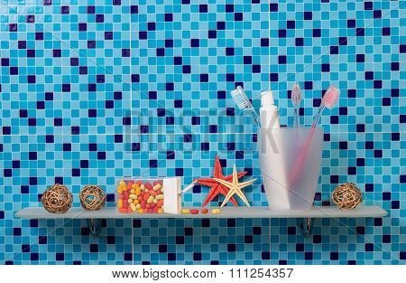 Toothbrushes and paste in cup