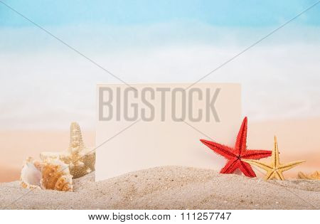 Card, starfishes and shells