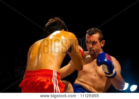 Muay Thai Boxers Kick Ribs Sweat