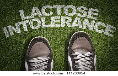 Top View of Sneakers on the grass with the text: Lactose Intolerance