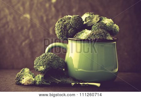Still Life With Fresh Green Broccoli In Ceramic Cup On Black Stone Plate , Vintage And Retro Color T