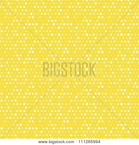 Light yellow and white dotted vector seamless pattern.