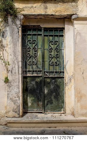 Green Old Door with a Grid