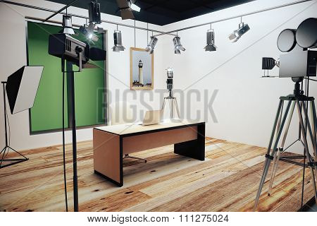 Modern Photo Studio With Furniture And Old Style Movie Camera