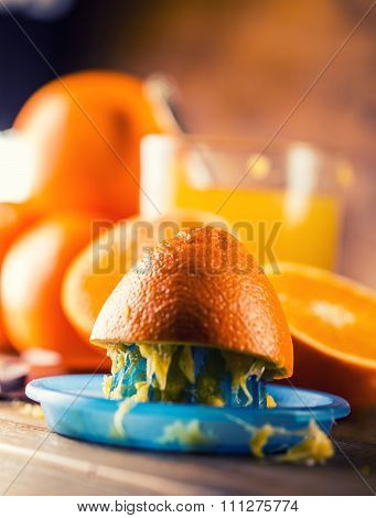Fresh oranges. Pressed orange manual method. Oranges and sliced oranges with juice and