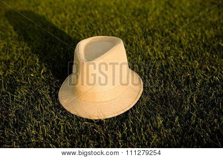 Cream Girlish Hat On The Green Grass