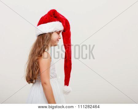 Little Girl Kid In Santa Claus Hat. Christmas.