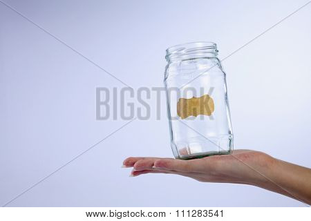 female's hand holding a empty jar