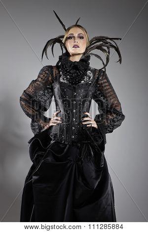 Model In Extravagant Black Dress