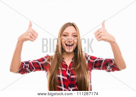 Excited Young Girl Showing Gesture Thumbs Up