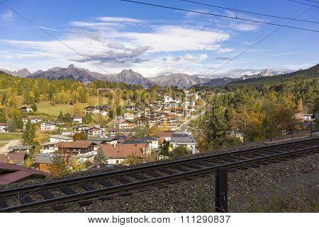 Quaint Alpine Village With Train Tracks