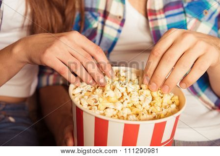 Young Woman And Man  Eating Popcorn In The Cinema