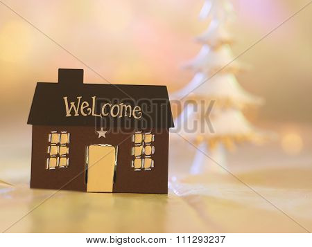 house shape light holder with christmas tree