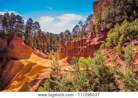 Scenic pit mining ocher - natural dyes. Roussillon, Provence Red Village