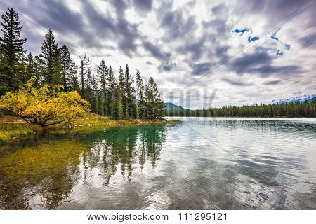 Jasper National Park, lake Annette, Canadian Rocky Mountains. Quiet lake in the nature reserve