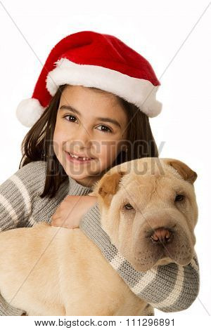 Cute Brunette Girl Holding A Shar Pei Puppy Wearing A Santa Hat